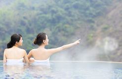 Happy young woman relaxing in  hot springs Stock Images