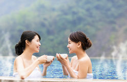 Happy young woman relaxing in  hot springs Royalty Free Stock Images