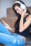 Happy young woman relaxing listening to music Stock Photos