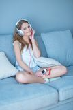 Happy young woman relaxing listening to music Royalty Free Stock Image