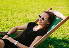 Happy Young Woman Relaxing Outdoor Stock Image