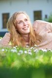 Happy young woman relaxing outdoors Royalty Free Stock Photos