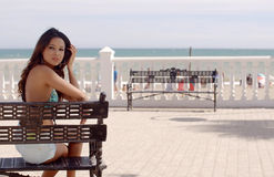 Happy young woman relaxing in sun at the sea Royalty Free Stock Photo