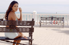 Happy young woman relaxing in sun at the sea Royalty Free Stock Photos
