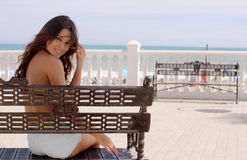 Happy young woman relaxing in sun at the sea Stock Photo