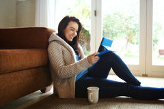Happy young woman relaxing with tablet at home Royalty Free Stock Images