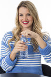 Happy Young Woman Removing Lid From Bottle Of Mineral Water Stock Images
