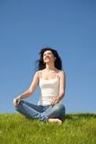 Happy young woman rest on the grass Stock Photo