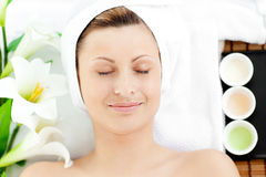Happy young woman resting on a massage table Royalty Free Stock Photography