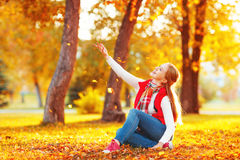 Happy young woman resting outdoors in autumn Royalty Free Stock Photography