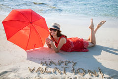 Happy young woman resting on a sandy beach Royalty Free Stock Photos