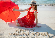 Happy young woman resting on a sandy beach Stock Image