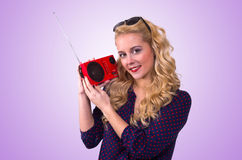 Happy Young Woman with retro radio Stock Images