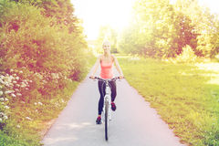 Happy young woman riding bicycle outdoors Royalty Free Stock Images