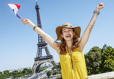 Happy young woman rising flag in front of Eiffel tower in Paris. Having fun time near the world famous landmark in Paris. Portrait of happy young woman in bright stock photos