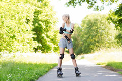 Happy young woman in rollerblades riding outdoors Royalty Free Stock Images