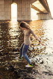 Happy young woman running back from water royalty free stock images