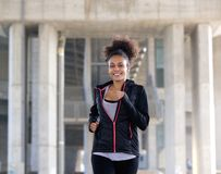 Happy young woman running exercise Stock Images