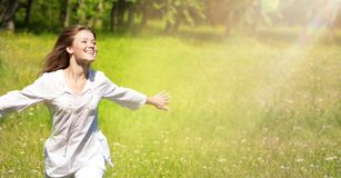 Happy Young Woman Enjoying Summer on the Green Meadow. Royalty Free Stock Image