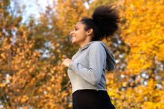 Happy young woman running outdoors Royalty Free Stock Image