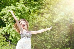 Happy Young Woman Enjoying Summer on the Green Meadow. Royalty Free Stock Photos