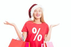 Happy young woman with santa hat Stock Photography