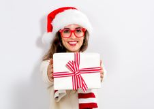 Young woman holding a Christmas gift Stock Photos