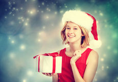 Happy young woman with Santa hat Stock Images