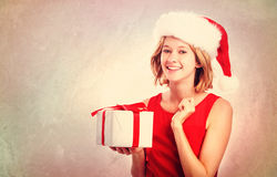 Happy young woman with Santa hat Royalty Free Stock Photography