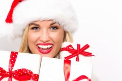 Young woman holding Christmas gifts stock photo