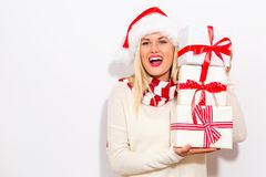 Young woman holding Christmas gifts stock image