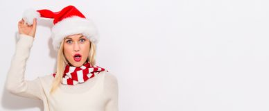 Happy young woman with Santa hat royalty free stock photos