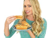 Happy Young Woman With Sausage Rolls Royalty Free Stock Image