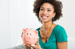 Happy Woman Holding Piggybank Stock Photo
