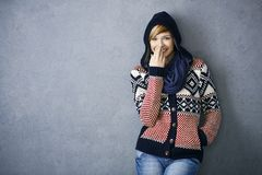 Happy young woman in scandinavian sweater royalty free stock image