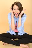 Happy Young Woman Screaming Yelling With Deiight. A DSLR royalty free image, of attractive young woman sitting on floor with crossed legs, screaming yelling with Stock Photos