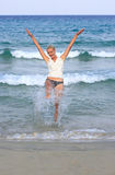 Happy young woman in sea Stock Images