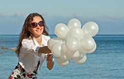 Happy young woman at the sea Stock Image