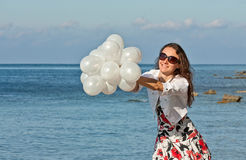Happy young woman at the sea Royalty Free Stock Photos