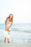 Happy young woman at seaside in the evening Stock Photo