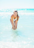 Happy young woman at seaside playing with water Royalty Free Stock Photos