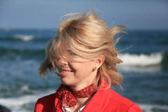 Happy young woman shaking head near sea Stock Photos