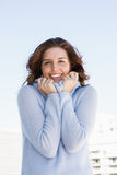 Happy young woman shivering Royalty Free Stock Photos