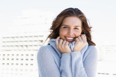 Happy young woman shivering Stock Photo