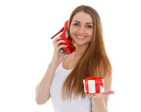 Happy young woman with shoe. Royalty Free Stock Photography