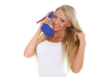 Happy young woman with shoe. Stock Photos