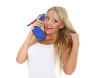 Happy young woman with shoe. Royalty Free Stock Photo