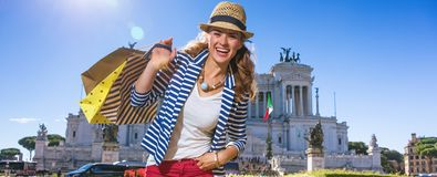 Happy young woman shopper at Piazza Venezia in Rome, Italy. Roman Holiday. Portrait of happy young woman at Piazza Venezia in Rome, Italy with shopping bags stock image