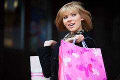 Happy young woman shopping Royalty Free Stock Image