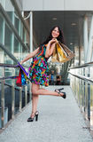 Happy young fashion woman shopping bags in the mall Stock Photography